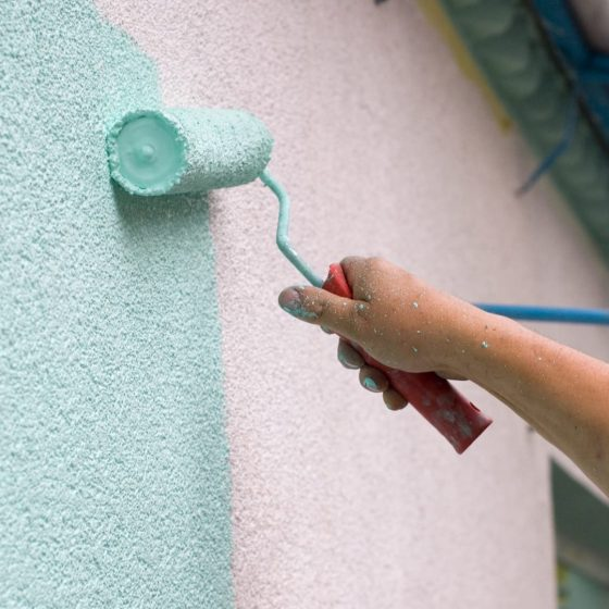 painting and repairing stucco home